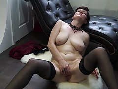 Busty short haired mature babe Olivia G. exposes her tits and pussy