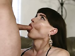 Aroused titless Tgirl Natalie Mars stands on knees to give a good BJ