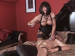 Mistress ass spanks male slave before fucking him with the strap-on